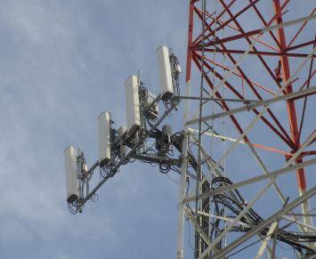 5G Cellular tower showing typical RRH installation behind antennas